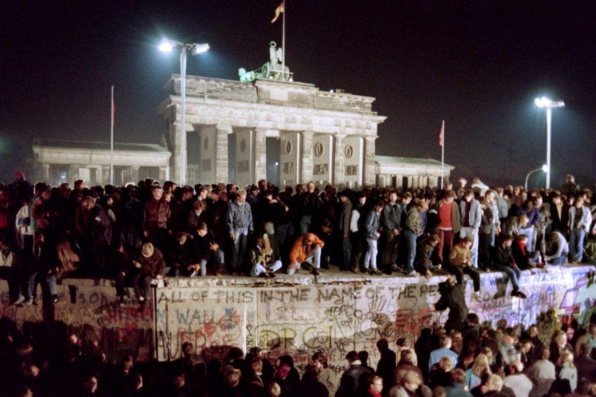 East Berliners crowd atop the Berlin Wall