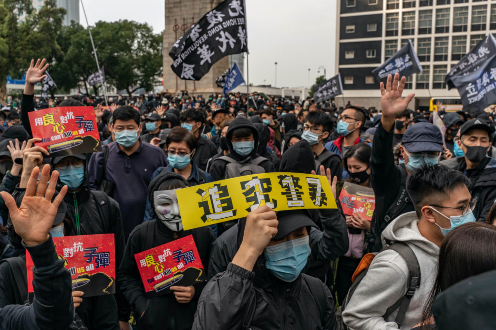Hong Kong Police Fire Tear Gas to Disperse Thousands Calling for International Sanctions on Chinese Officials