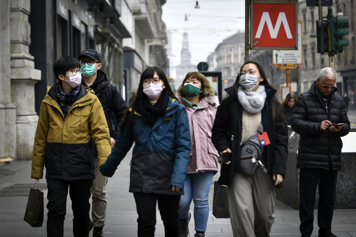 people wearing masks in italy
