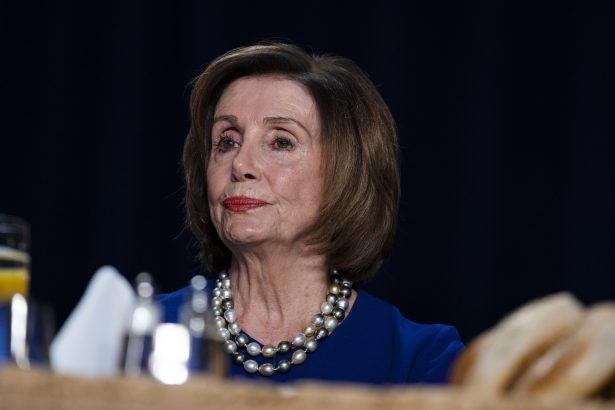 House Speaker Nancy Pelosi (D-Calif.) listens