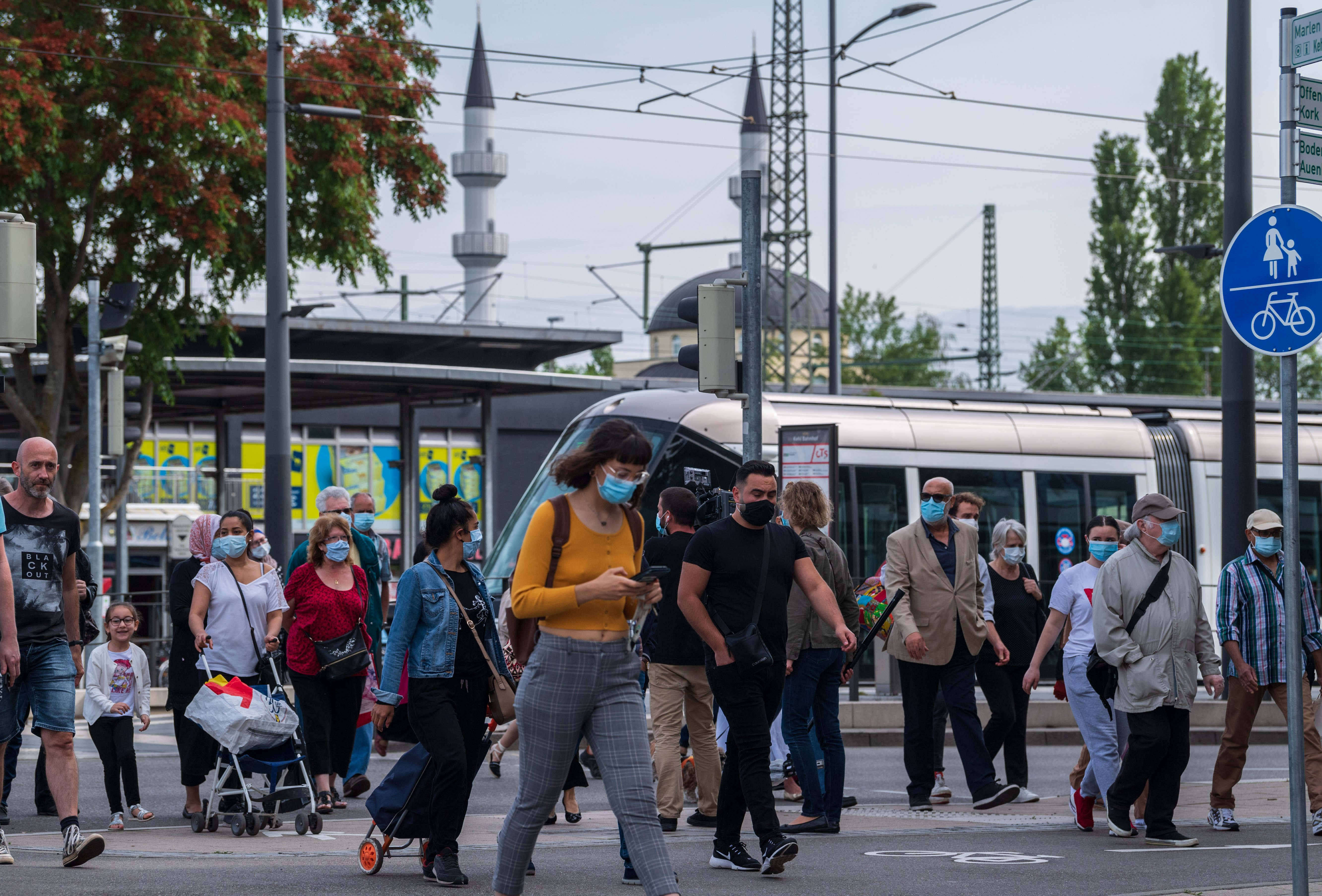 French passengers step out of the tram