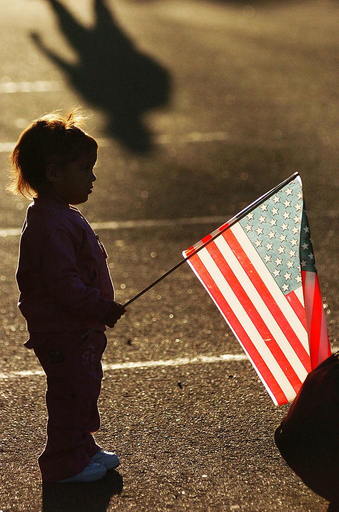child holding flag